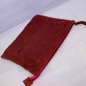Tumbled leather clutch tablet sleeve bag
